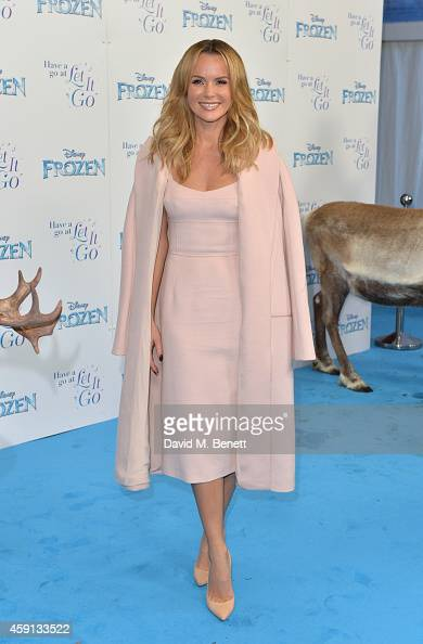 Amanda Holden attends a celebrity singalong from 'Frozen' at Royal Albert Hall on November 17 2014 in London England She is wearing a pink Jasper...