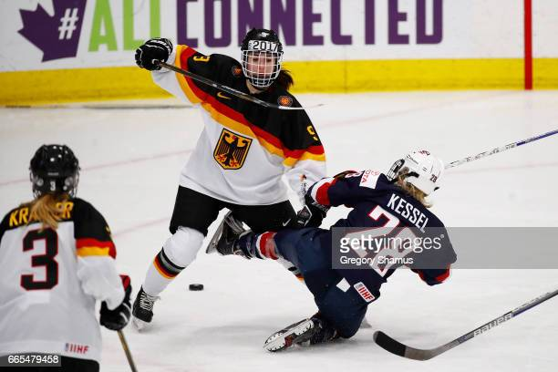 Amanda Kessel of the United States battles for the puck with Rebecca Graeve of Germany in the third period during a semifinal game at the 2017 IIHF...