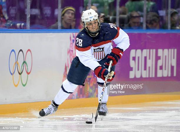 Amanda Kessel of the United States handles the puck against Canada during the Ice Hockey Women's Gold Medal Game on day 13 of the Sochi 2014 Winter...