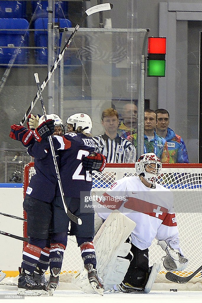 <a gi-track='captionPersonalityLinkClicked' href=/galleries/search?phrase=Amanda+Kessel&family=editorial&specificpeople=9030355 ng-click='$event.stopPropagation()'>Amanda Kessel</a> (28) of the U.S.A. celebrates her goal with teammate Brianna Decker (14) as <a gi-track='captionPersonalityLinkClicked' href=/galleries/search?phrase=Florence+Schelling&family=editorial&specificpeople=723566 ng-click='$event.stopPropagation()'>Florence Schelling</a> (41) of the Switzerland reacts during the first period of action at the Shayba Arena. Sochi 2014 Winter Olympics on Monday, February 10, 2014.