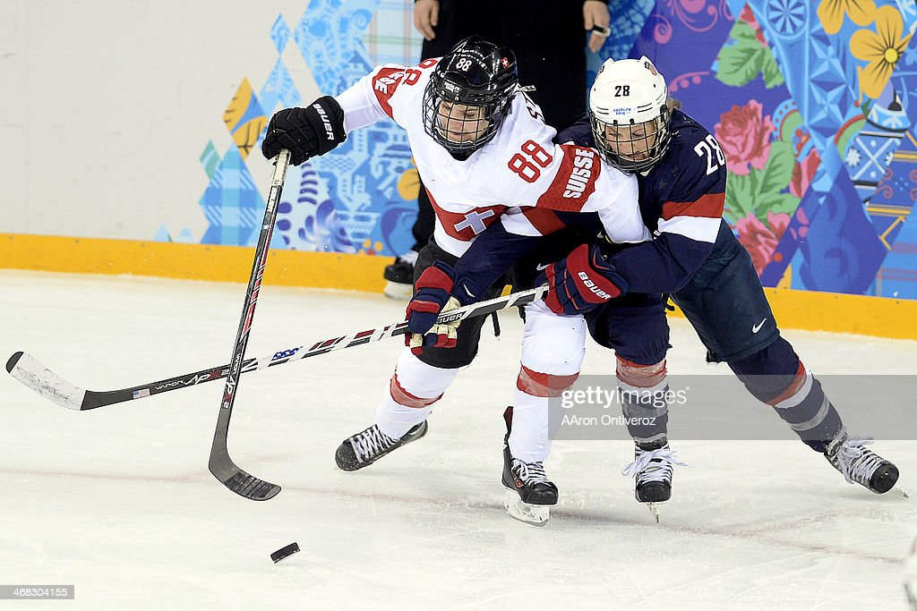 <a gi-track='captionPersonalityLinkClicked' href=/galleries/search?phrase=Amanda+Kessel&family=editorial&specificpeople=9030355 ng-click='$event.stopPropagation()'>Amanda Kessel</a> (28) of the U.S.A. defends Phoebe Stanz (88) of the Switzerland during the third period of the United States' 9-0 win at the Shayba Arena. Sochi 2014 Winter Olympics on Monday, February 10, 2014.