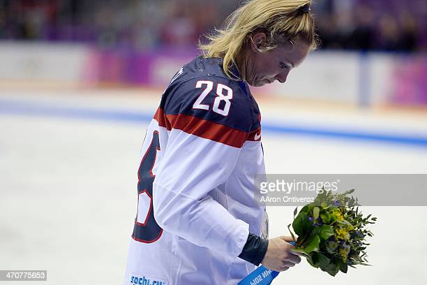 Amanda Kessel of the USA hangs her head after the overtime period of Canada's 32 gold medal ice hockey win over the USA Sochi 2014 Winter Olympics on...