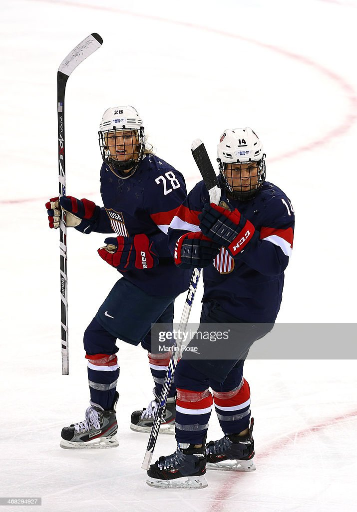 <a gi-track='captionPersonalityLinkClicked' href=/galleries/search?phrase=Amanda+Kessel&family=editorial&specificpeople=9030355 ng-click='$event.stopPropagation()'>Amanda Kessel</a> #28 of United States celebrates with team-mate Brianna Decker #14 of United States after scoring her team's fifth goal in the first period during the Women's Ice Hockey Preliminary Round Group A game on day three of the Sochi 2014 Winter Olympics at Shayba Arena on February 10, 2014 in Sochi, Russia.