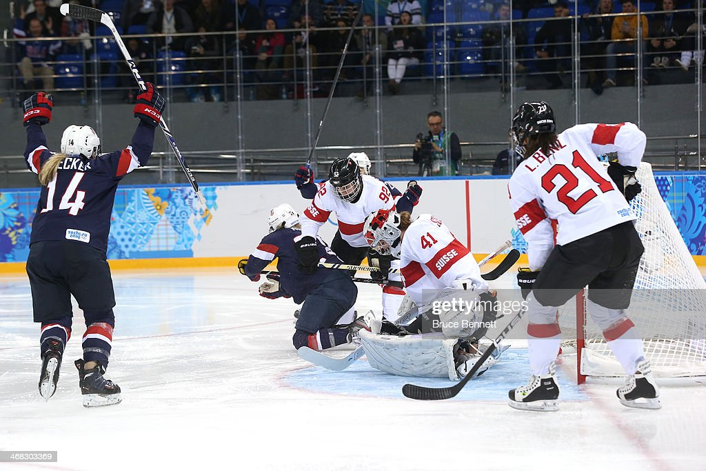 <a gi-track='captionPersonalityLinkClicked' href=/galleries/search?phrase=Amanda+Kessel&family=editorial&specificpeople=9030355 ng-click='$event.stopPropagation()'>Amanda Kessel</a> #28 of United States scores her team's eigth goal past Florence Schelling #41 of Switzerland during the Women's Ice Hockey Preliminary Round Group A game on day three of the Sochi 2014 Winter Olympics at Shayba Arena on February 10, 2014 in Sochi, Russia.