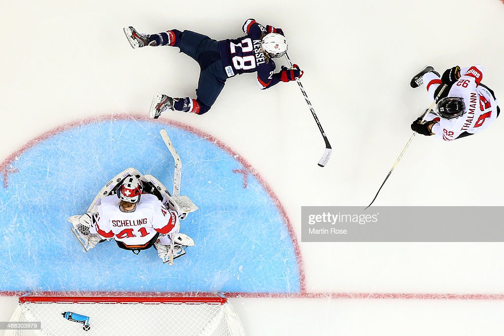 <a gi-track='captionPersonalityLinkClicked' href=/galleries/search?phrase=Amanda+Kessel&family=editorial&specificpeople=9030355 ng-click='$event.stopPropagation()'>Amanda Kessel</a> #28 of United States scores her team's eigth goal past <a gi-track='captionPersonalityLinkClicked' href=/galleries/search?phrase=Florence+Schelling&family=editorial&specificpeople=723566 ng-click='$event.stopPropagation()'>Florence Schelling</a> #41 of Switzerland during the Women's Ice Hockey Preliminary Round Group A game on day three of the Sochi 2014 Winter Olympics at Shayba Arena on February 10, 2014 in Sochi, Russia.