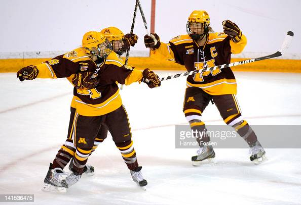 Amanda Kessel Rachael Bona and Jen Schoullis of the Minnesota Gophers celebrate a goal by Kessel during the first period of the championship game of...
