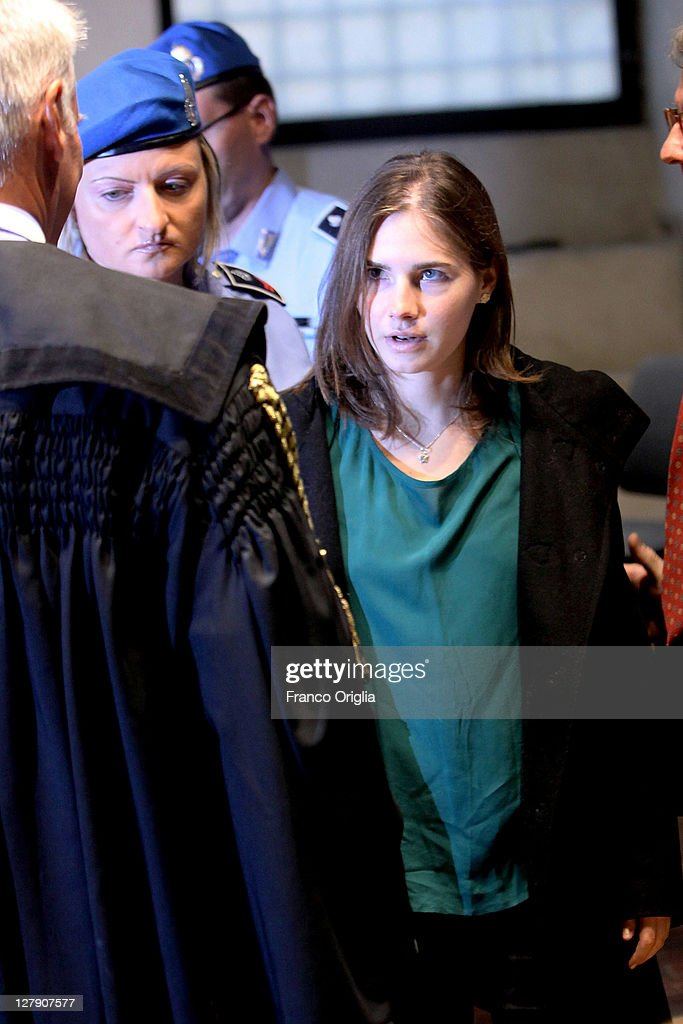 <a gi-track='captionPersonalityLinkClicked' href=/galleries/search?phrase=Amanda+Knox&family=editorial&specificpeople=4681704 ng-click='$event.stopPropagation()'>Amanda Knox</a> arrives at Perugia's Court of Appeal the day of the verdict in her and Raffaele Sollecito's appeal of their murder convictions on October 3, 2011 in Perugia, Italy. American student <a gi-track='captionPersonalityLinkClicked' href=/galleries/search?phrase=Amanda+Knox&family=editorial&specificpeople=4681704 ng-click='$event.stopPropagation()'>Amanda Knox</a> and her Italian ex-boyfriend Raffaele Sollecito were convicted in 2009 of killing their British roommate Meredith Kercher in Perugia, Italy in 2007. The jury in their appeal is expected to retire to consider their verdict later today. They have served nearly four years in jail after being sentenced to 26 and 25 years respectively.