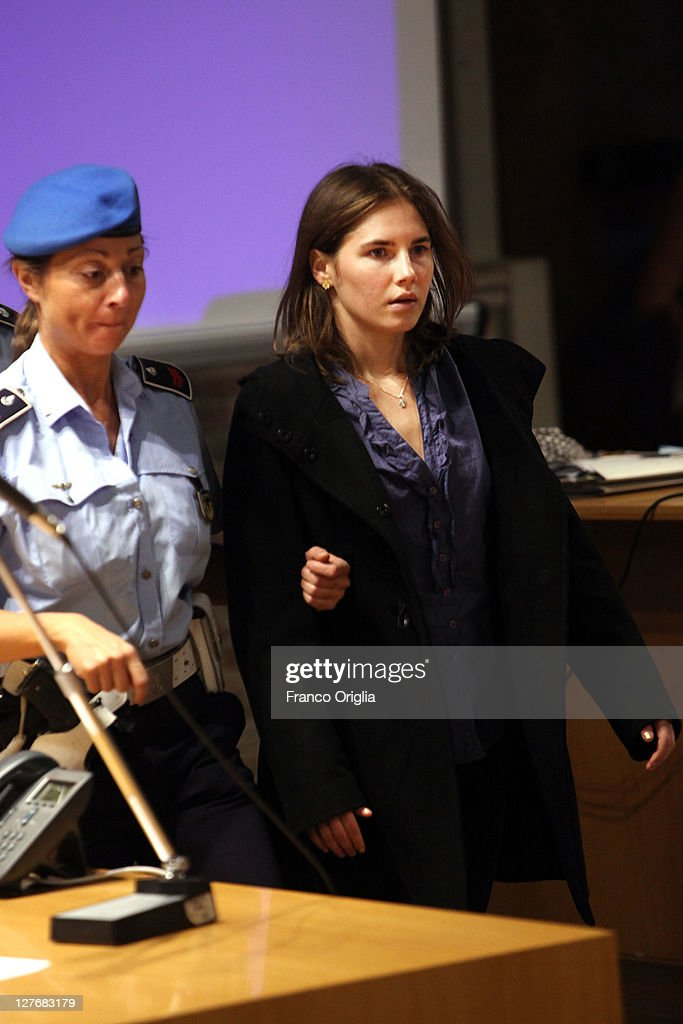<a gi-track='captionPersonalityLinkClicked' href=/galleries/search?phrase=Amanda+Knox&family=editorial&specificpeople=4681704 ng-click='$event.stopPropagation()'>Amanda Knox</a> attends her appeal hearing at Perugia's Court of Appeal on September 30, 2011 in Perugia, Italy. <a gi-track='captionPersonalityLinkClicked' href=/galleries/search?phrase=Amanda+Knox&family=editorial&specificpeople=4681704 ng-click='$event.stopPropagation()'>Amanda Knox</a> and Raffaele Sollecito are awaiting the verdict of their appeal that could see their conviction for the murder of Meredith Kercher overturned. American student <a gi-track='captionPersonalityLinkClicked' href=/galleries/search?phrase=Amanda+Knox&family=editorial&specificpeople=4681704 ng-click='$event.stopPropagation()'>Amanda Knox</a> and her Italian ex-boyfriend Raffaele Sollecito, who were convicted in 2009 of killing their British roommate Meredith Kercher in Perugia, Italy in 2007, have served nearly four years in jail after being sentenced to 26 and 25 years respectively.