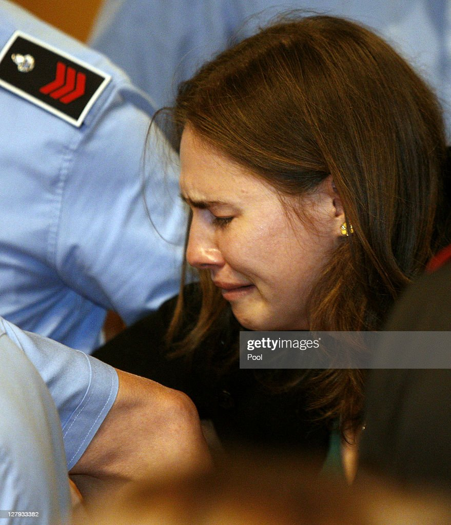 <a gi-track='captionPersonalityLinkClicked' href=/galleries/search?phrase=Amanda+Knox&family=editorial&specificpeople=4681704 ng-click='$event.stopPropagation()'>Amanda Knox</a> breaks down in tears as she is taken away after hearing the verdict that overturns her conviction and acquits her of murdering her British roommate Meredith Kercher, at the Perugia court on October 3, 2011 in Perugia, Italy. American student <a gi-track='captionPersonalityLinkClicked' href=/galleries/search?phrase=Amanda+Knox&family=editorial&specificpeople=4681704 ng-click='$event.stopPropagation()'>Amanda Knox</a> and her Italian ex-boyfriend Raffaele Sollecito have won their appeal against their conviction in 2009 of killing their British roommate Meredith Kercher in Perugia, Italy in 2007. The pair had served nearly four years in jail after initially being sentenced to 26 and 25 years respectively.