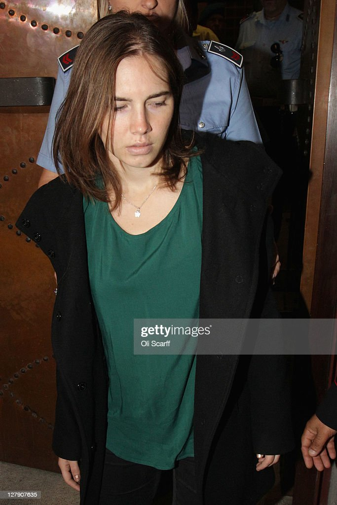<a gi-track='captionPersonalityLinkClicked' href=/galleries/search?phrase=Amanda+Knox&family=editorial&specificpeople=4681704 ng-click='$event.stopPropagation()'>Amanda Knox</a> is escorted to her appeal hearing at Perugia's Court of Appeal on October 3, 2011 in Perugia, Italy. American student <a gi-track='captionPersonalityLinkClicked' href=/galleries/search?phrase=Amanda+Knox&family=editorial&specificpeople=4681704 ng-click='$event.stopPropagation()'>Amanda Knox</a> and her Italian ex-boyfriend Raffaele Sollecito were convicted in 2009 of killing their British roommate Meredith Kercher in Perugia, Italy in 2007. The jury in their appeal is expected to retire to consider their verdict later today. They have served nearly four years in jail after being sentenced to 26 and 25 years respectively.