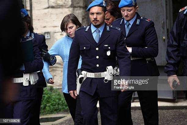 Amanda Knox is led away from Perugia's court of Appeal by police officers after the first session of her appeal against her murder conviction on...