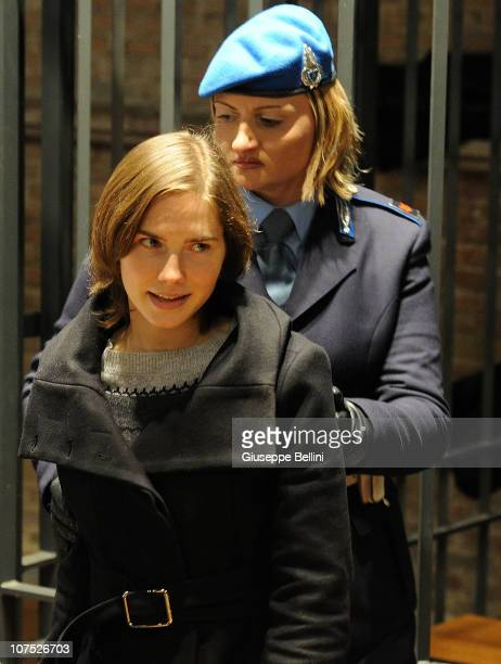 Amanda Knox is led through court during her appeal hearing over the guilty verdict in the murder of Meredith Kercher on December 11 2010 in Perugia...