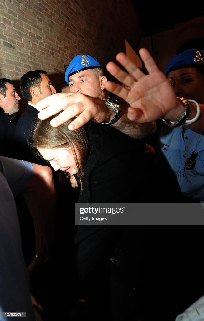 <a gi-track='captionPersonalityLinkClicked' href=/galleries/search?phrase=Amanda+Knox&family=editorial&specificpeople=4681704 ng-click='$event.stopPropagation()'>Amanda Knox</a> leaves Perugia's Court of Appeal in tears after learning that she won her appeal against her murder conviction on October 3, 2011 in Perugia, Italy. American student <a gi-track='captionPersonalityLinkClicked' href=/galleries/search?phrase=Amanda+Knox&family=editorial&specificpeople=4681704 ng-click='$event.stopPropagation()'>Amanda Knox</a> and her Italian ex-boyfriend Raffaele Sollecito have won their appeal against their conviction in 2009 of killing their British roommate Meredith Kercher in Perugia, Italy in 2007. The pair had served nearly four years in jail after initially being sentenced to 26 and 25 years respectively.