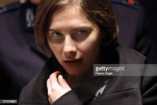 Amanda Knox returns after a break in court proceedings at Perugia's Court of Appeal during the second session of her appeal against her conviction...