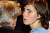 Amanda Knox speaks with her legal team in Perugia's court of Appeal during the first session of her appeal against her murder conviction on November...