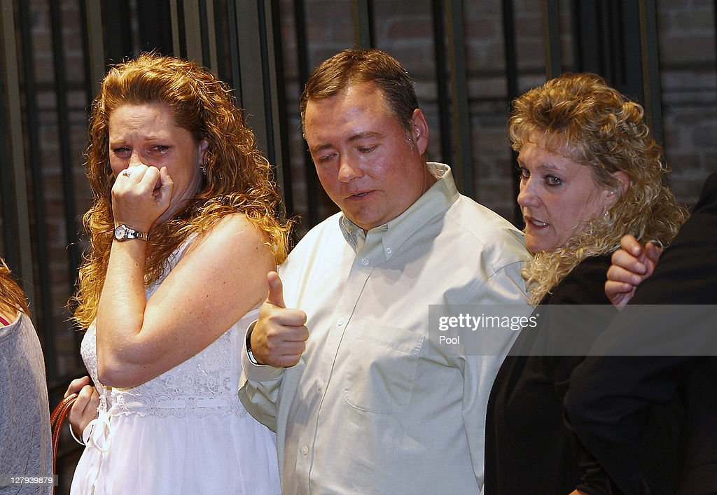 Amanda Knox's aunt Janet Huff, stepfather Chris Mellas, and Cassandra Knox, second wife of Amanda's father Curt, react after hearing the verdict that overturns Amanda's conviction and acquits her of murdering her British roommate Meredith Kercher, at the Perugia court on October 3, 2011 in Perugia, Italy. American student Amanda Knox and her Italian ex-boyfriend Raffaele Sollecito have won their appeal against their conviction in 2009 of killing their British roommate Meredith Kercher in Perugia, Italy in 2007. The pair had served nearly four years in jail after initially being sentenced to 26 and 25 years respectively.