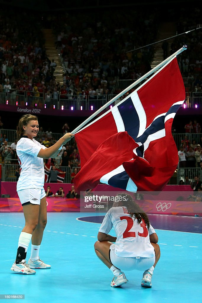 Amanda Kurtovic #22 and Camilla Herrem #23 of Norway celebrate winning the gold medal against Montenegro in the Women's Handball Final Match on Day 15 of the London 2012 Olympics Games at Basketball Arena on August 11, 2012 in London, England.