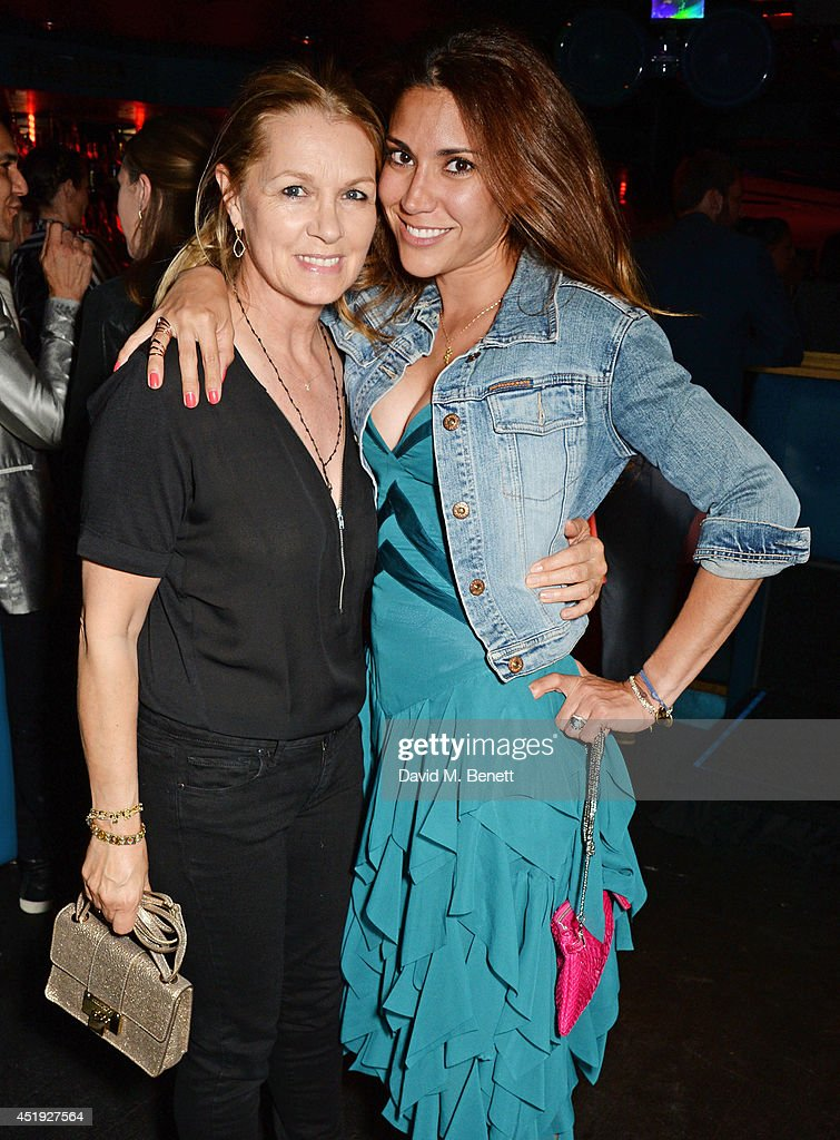 Amanda Kyme (L) and Lily Hodges attend Jo Wood and Yasmin Mill's Summer Party at Boujis on July 9, 2014 in London, England.