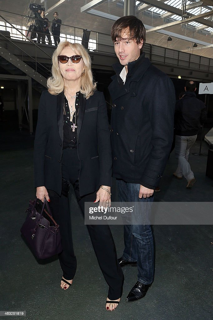 <a gi-track='captionPersonalityLinkClicked' href=/galleries/search?phrase=Amanda+Lear&family=editorial&specificpeople=2028746 ng-click='$event.stopPropagation()'>Amanda Lear</a> and Anthony Hornez attend the Givenchy Menswear Fall/Winter 2014-2015 Show as part of Paris Fashion Week on January 17, 2014 in Paris, France.