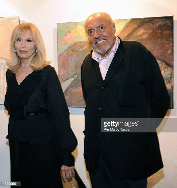 Amanda Lear and Elio Fiorucci attend opening of her exhibition at Milano Art Gallery on July 31 2013 in Milan Italy