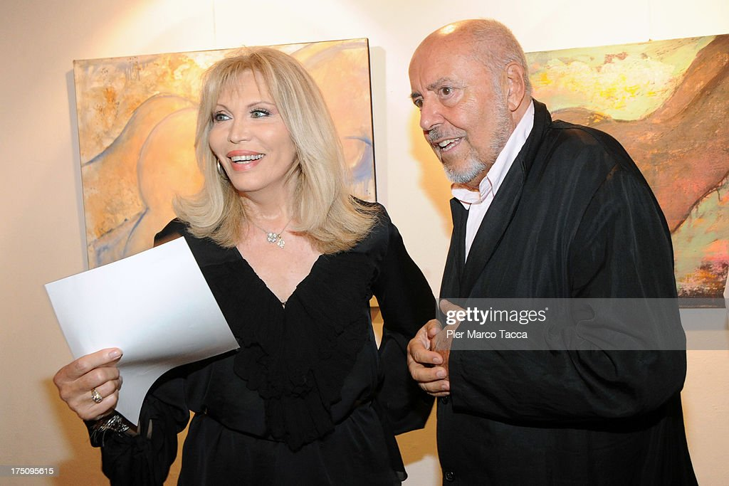 <a gi-track='captionPersonalityLinkClicked' href=/galleries/search?phrase=Amanda+Lear&family=editorial&specificpeople=2028746 ng-click='$event.stopPropagation()'>Amanda Lear</a> and <a gi-track='captionPersonalityLinkClicked' href=/galleries/search?phrase=Elio+Fiorucci&family=editorial&specificpeople=639457 ng-click='$event.stopPropagation()'>Elio Fiorucci</a> attend opening of her exhibition at Milano Art Gallery on July 31, 2013 in Milan, Italy.