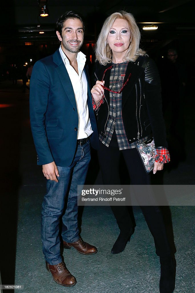 <a gi-track='captionPersonalityLinkClicked' href=/galleries/search?phrase=Amanda+Lear&family=editorial&specificpeople=2028746 ng-click='$event.stopPropagation()'>Amanda Lear</a> (R) and guest arriving at Givenchy show as part of the Paris Fashion Week Womenswear Spring/Summer 2014, held at 'la Halle Freyssinet' on September 29, 2013 in Paris, France.