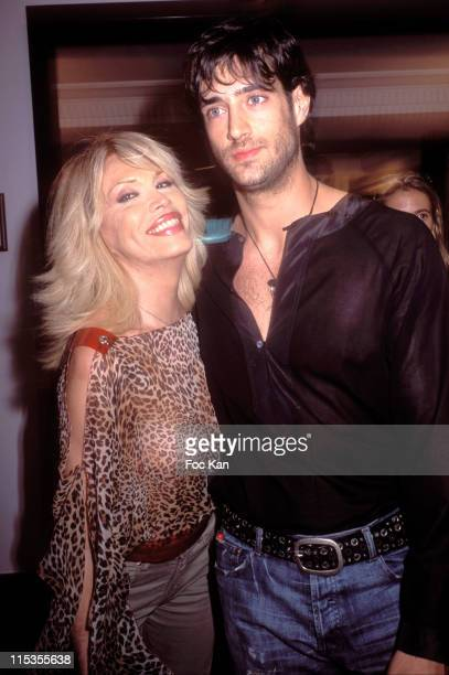 Amanda Lear and guest during 2004 Cannes Film Festival The Cathy Guetta Party at Martinez Club in Cannes France