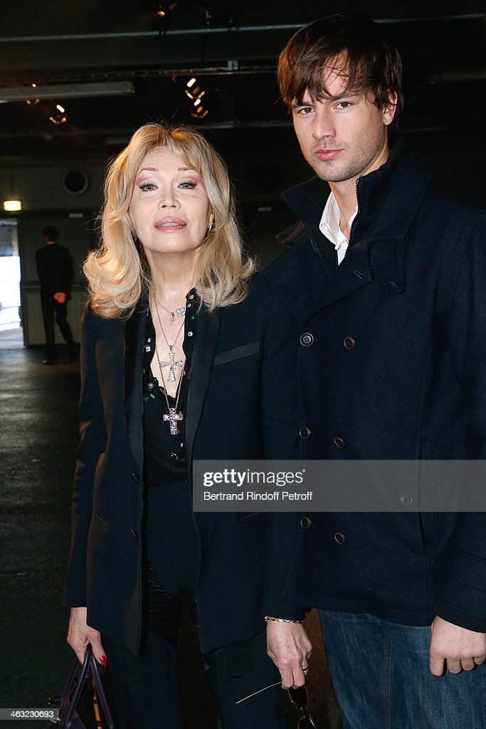 <a gi-track='captionPersonalityLinkClicked' href=/galleries/search?phrase=Amanda+Lear&family=editorial&specificpeople=2028746 ng-click='$event.stopPropagation()'>Amanda Lear</a> and her companion actor Anthony Hornez attends the Givenchy Menswear Fall/Winter 2014-2015 Show as part of Paris Fashion Week. Held at Halle Freyssinet on January 17, 2014 in Paris, France.