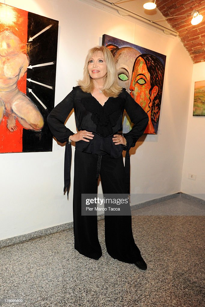 <a gi-track='captionPersonalityLinkClicked' href=/galleries/search?phrase=Amanda+Lear&family=editorial&specificpeople=2028746 ng-click='$event.stopPropagation()'>Amanda Lear</a> attends opening of her exhibition at Milano Art Gallery on July 31, 2013 in Milan, Italy.