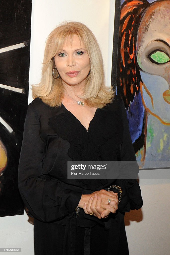 <a gi-track='captionPersonalityLinkClicked' href=/galleries/search?phrase=Amanda+Lear&family=editorial&specificpeople=2028746 ng-click='$event.stopPropagation()'>Amanda Lear</a> attends opening of her exhibitionat Milano Art Gallery on July 31, 2013 in Milan, Italy.