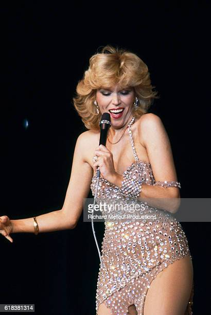 Amanda Lear performs at the Moulin Rouge on the occasion of the famous dance hall's 90th anniversary Celebrities Jerry Lewis Charles Aznavour Ginger...