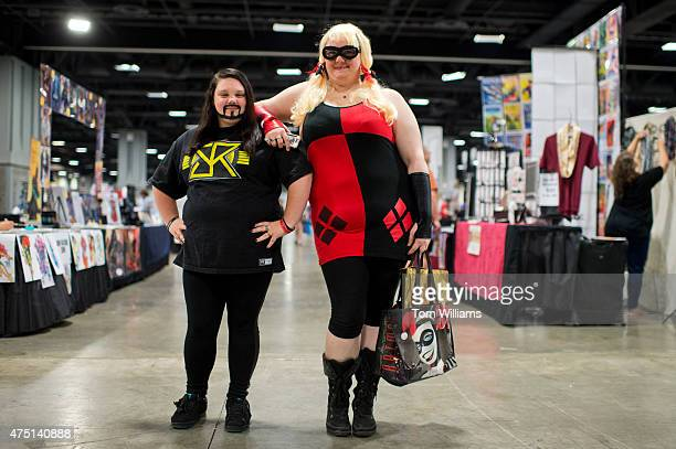 Amanda left of Glen Burnie Md dressed as wrestler Seth Rollins and Crystal dressed as Harley Quinn attend Awesome Con which celebrates scifi comics...