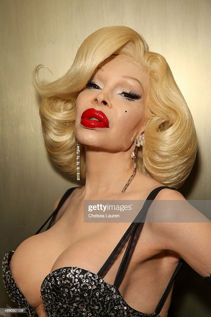 <a gi-track='captionPersonalityLinkClicked' href=/galleries/search?phrase=Amanda+Lepore&family=editorial&specificpeople=213255 ng-click='$event.stopPropagation()'>Amanda Lepore</a> backstage at the The Blonds fashion show during MADE Fashion Week Fall 2014 at Milk Studios on February 12, 2014 in New York City.