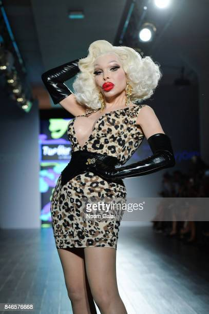 Amanda Lepore walks the runway at the Tumbler and Tipsy by Michael Kuluva fashion show at Metropolitan West on September 13 2017 in New York City