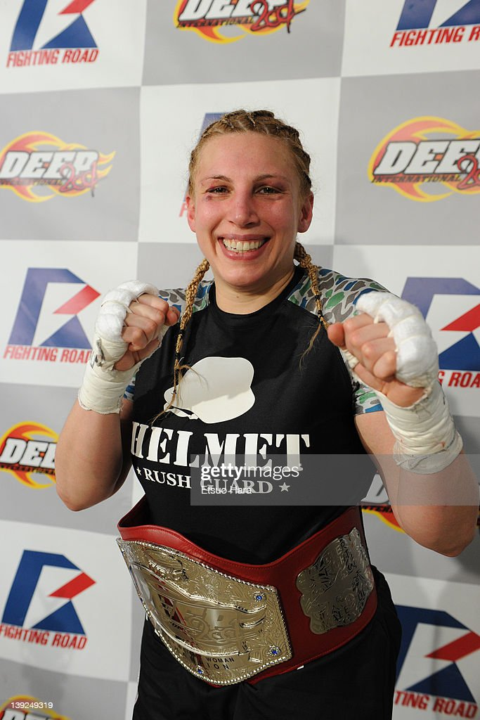 Amanda Lucas, daughter of film director George Lucas and the new DEEP woman's open weight champion poses with the belt in her post match media conference after the DEEP57 fight against Yumiko Hotta at Tokyo Dome City Hall on February 18, 2012 in Tokyo, Japan.