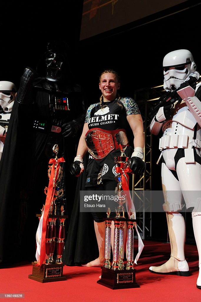 Amanda Lucas, daughter of film director George Lucas and the new DEEP women's open weight champion poses for photographs with the trophies, Star Wars character Darth Vader and Stormtroopers after her match against Yumiko Hotta during the DEEP57 at Tokyo Dome City Hall on February 18, 2012 in Tokyo, Japan.
