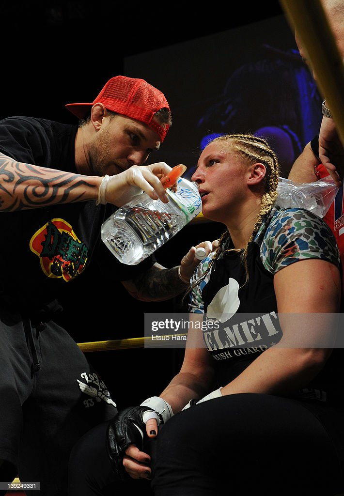 Amanda Lucas, daughter of film director George Lucas, drinks water during an interval in the DEEP57 fights against Yumiko Hotta at Tokyo Dome City Hall on February 18, 2012 in Tokyo, Japan.