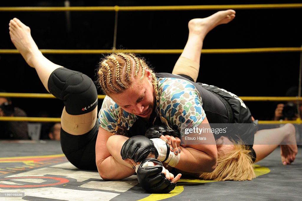 Amanda Lucas (top), daughter of film director George Lucas, fights against Yumiko Hotta during the DEEP57 at Tokyo Dome City Hall on February 18, 2012 in Tokyo, Japan.