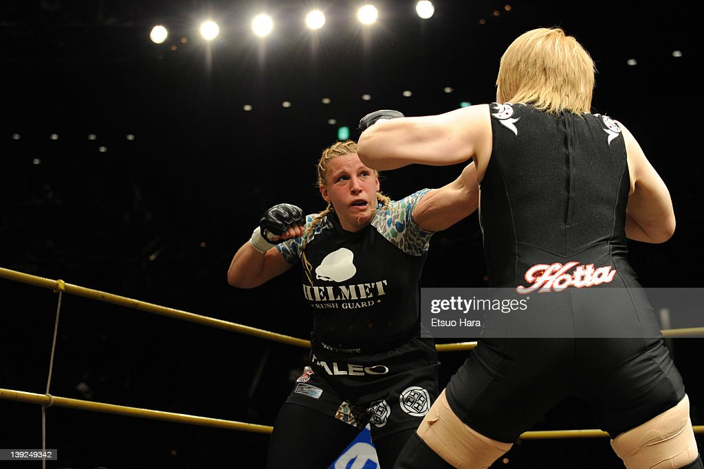 Amanda Lucas (L), daughter of film director George Lucas, fights against Yumiko Hotta during the DEEP57 at Tokyo Dome City Hall on February 18, 2012 in Tokyo, Japan.