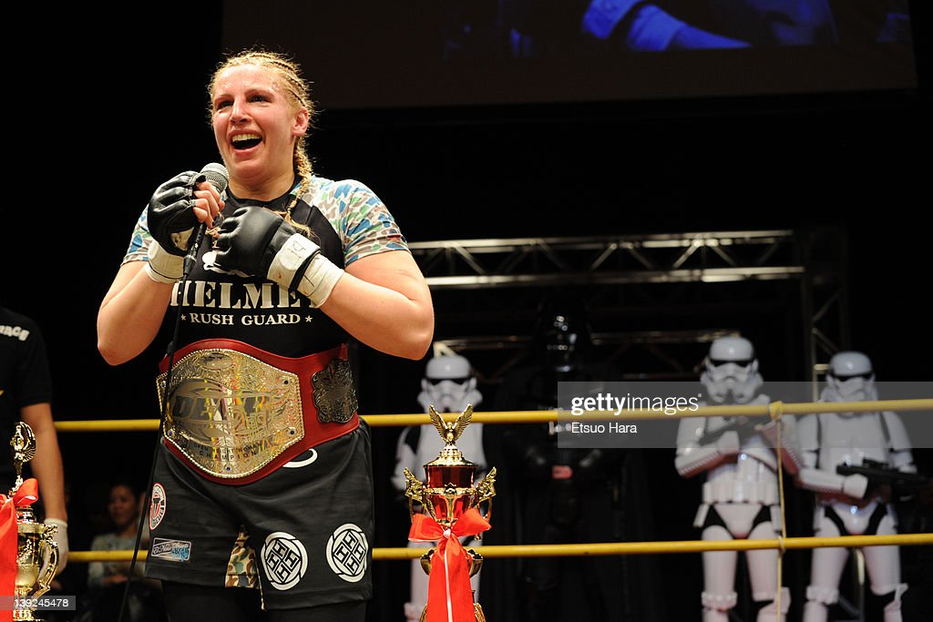 Amanda Lucas, daughter of film director Goerge Lucas, new DEEP women's open weight champion looks on with STAR WARS's character Darth Vader and Storm troopers during the DEEP57 at Tokyo Dome City Hall on February 18, 2012 in Tokyo, Japan.