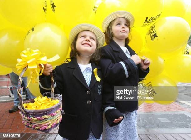 Amanda Lynch and Eabhan Murphy from Hedley Park Montessori school watch as 50 balloons are released into the sky above Dublin today to mark the 50th...