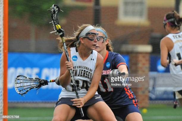 Amanda Muller of College of New Jersey is defended by Macauuley Mikes of Gettysburg College during the Division III Women's Lacrosse Championship...