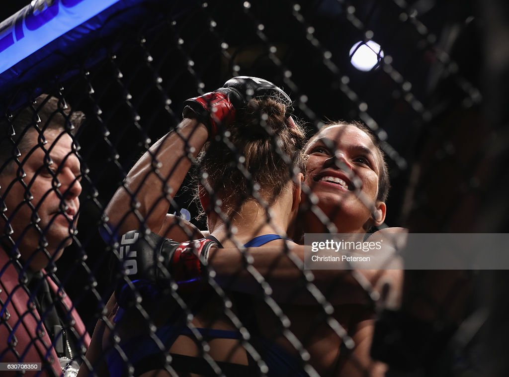Amanda Nunes of Brazil embraces Ronda Rousey after their UFC women's bantamweight championship bout during the UFC 207 event on December 30, 2016 in Las Vegas, Nevada.