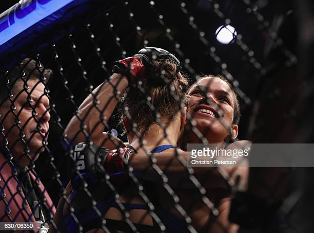 Amanda Nunes of Brazil embraces Ronda Rousey after their UFC women's bantamweight championship bout during the UFC 207 event on December 30 2016 in...