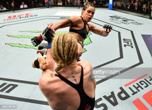 Amanda Nunes of Brazil kicks Valentina Shevchenko of Kyrgyzstan in their women's bantamweight bout during the UFC 215 event inside the Rogers Place...