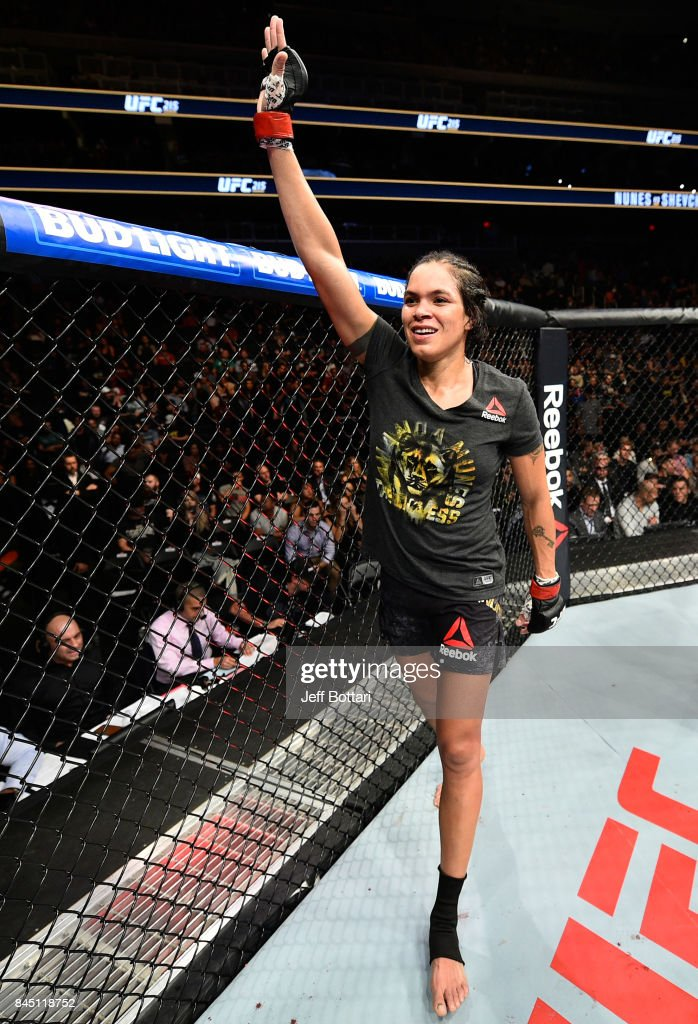 Amanda Nunes of Brazil raises her hand after facing Valentina Shevchenko of Kyrgyzstan in their women's bantamweight bout during the UFC 215 event inside the Rogers Place on September 9, 2017 in Edmonton, Alberta, Canada.