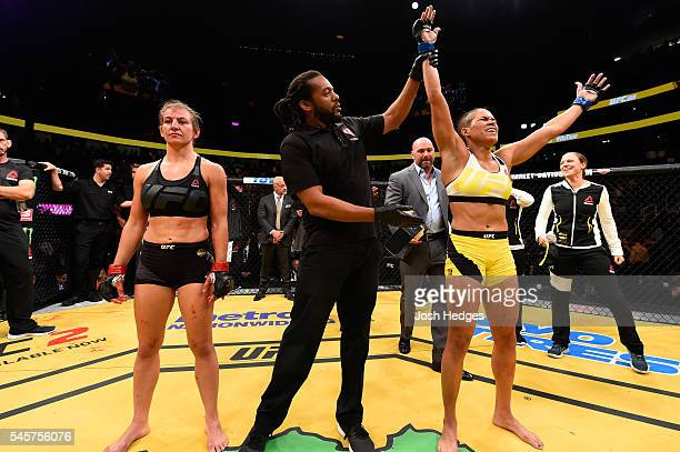 Amanda Nunes of Brazil reacts to her victory over Miesha Tate in their UFC women's bantamweight championship bout during the UFC 200 event on July 9...