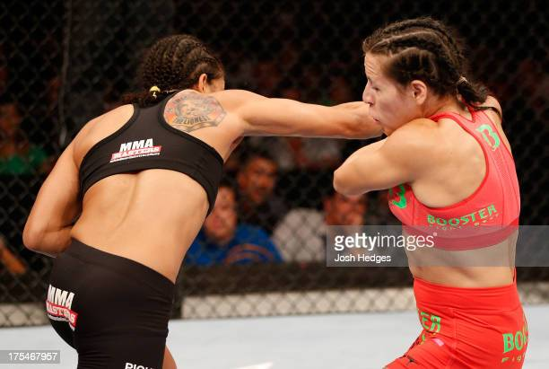 Amanda Nunes punches Sheila Gaff in their women's bantamweight bout during UFC 163 at HSBC Arena on August 3 2013 in Rio de Janeiro Brazil