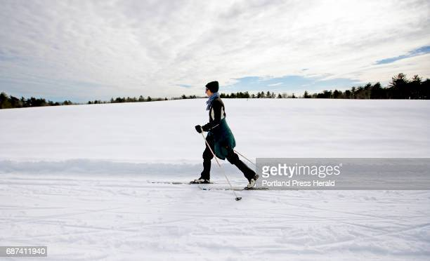 Amanda Painter of Portland skis across an open meadow at Smiling Hill Farm on Sunday