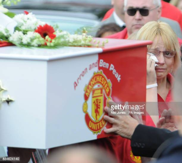 Amanda Peak the mother of the two boys killed in a car crash on the M6 watches as mourners carry the double Manchester United coffin of Ben and Arron...